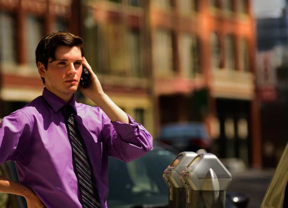 Male model as business man on the phone, urban, red, brick