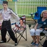 Memphis, Tennessee, USA, 15th August 2017. Elvis Week. Candlelight Vigil. People pay tribute to Elvis Presley at his Memphis home, Graceland. The Young Elvis Impersonator. The candlelight vigil is in it's 40th year. Elvis died 16 August 1977. photo credit: ©Gary Culley, 2017